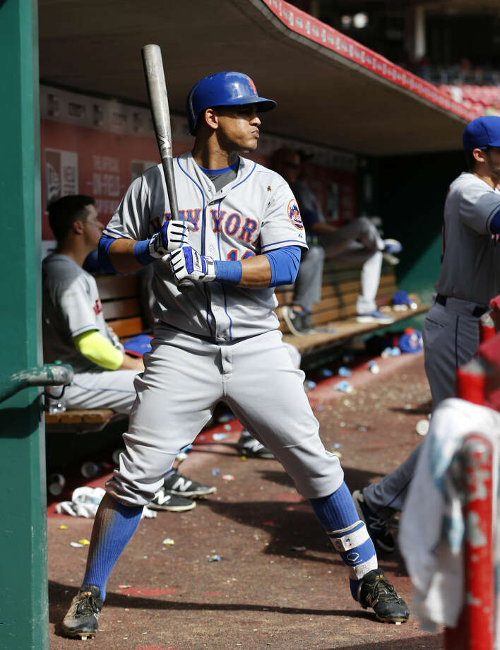 New York Mets Juan Lagares stands in the dugout waiting to bat in the sixth inning of a baseball game against the Cincinnati Reds, Sunday, Sept. 27, 2015, in Cincinnati. The Mets won 8-1. (AP Photo/Aaron Doster)