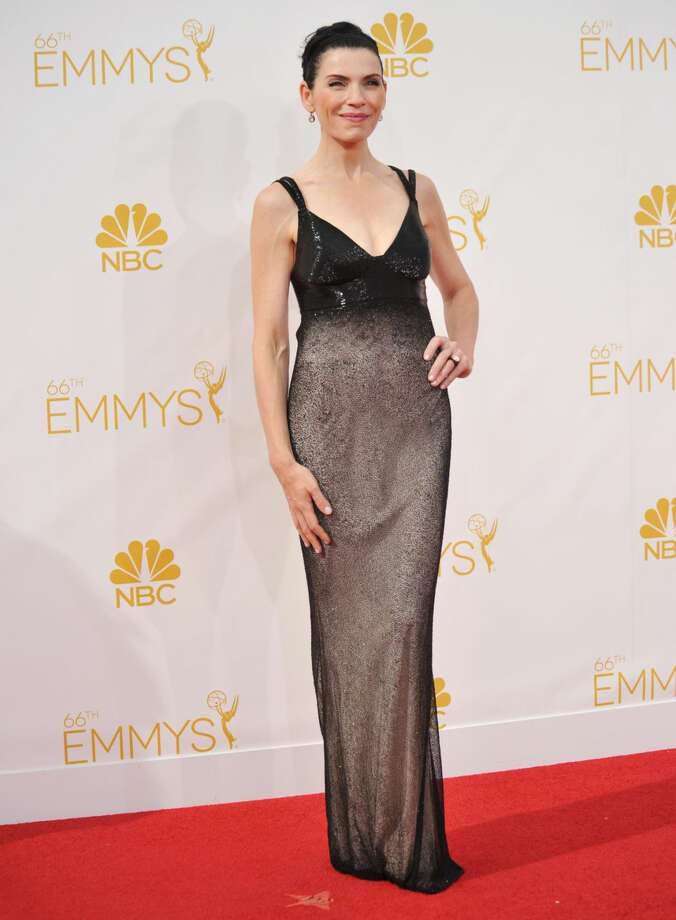 Julianna Margulies arrives at the 66th Annual Primetime Emmy Awards at the Nokia Theatre L.A. Live on Monday, Aug. 25, 2014, in Los Angeles. (Photo by Richard Shotwell/Invision/AP)