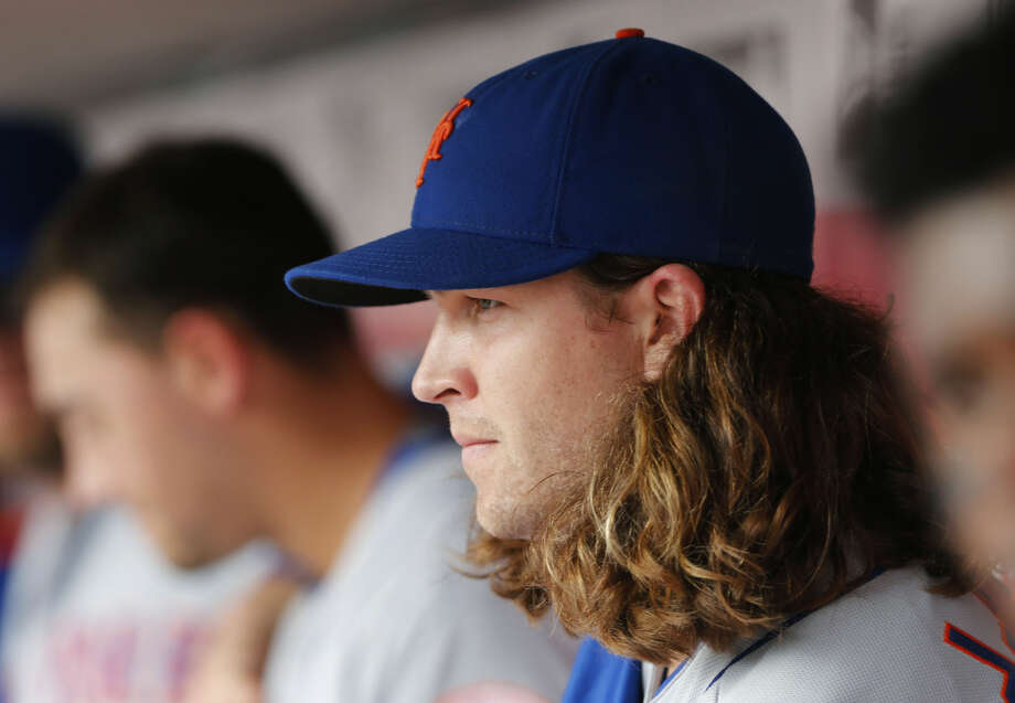 New York Mets Jacob deGrom looks on from the dugout in the second inning of a baseball game against the Cincinnati Reds, Sunday, Sept. 27, 2015, in Cincinnati. (AP Photo/Aaron Doster)