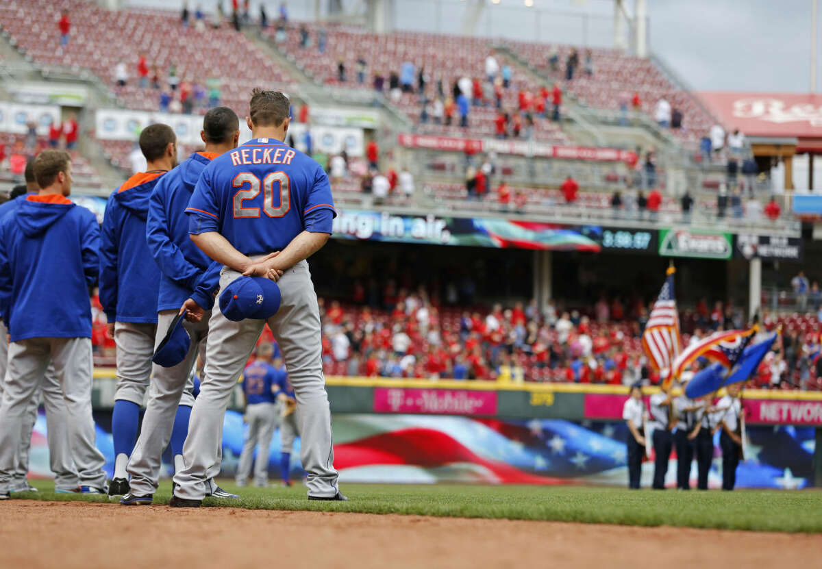 New York Mets catcher Anthony Recker (20) stands on the field during the national anthem before a baseball game of the Cincinnati Reds against the New York Mets, Saturday, Sept. 26, 2015, in Cincinnati. The Mets won 10-2. (AP Photo/Aaron Doster)