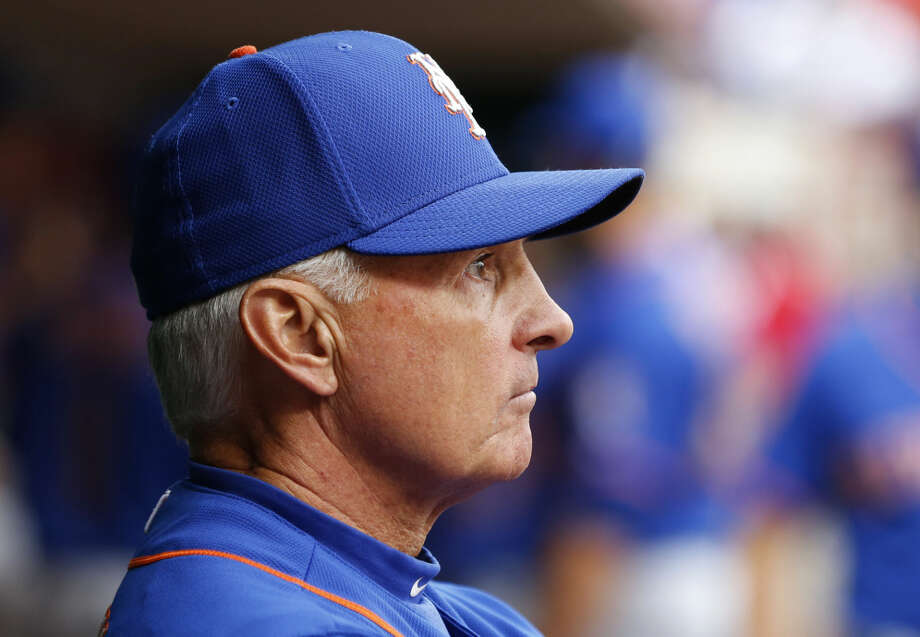 New York Mets manager Terry Collins (10) looks on in the dugout before a baseball game of the Cincinnati Reds against the New York Mets, Saturday, Sept. 26, 2015, in Cincinnati. The Mets won 10-2. (AP Photo/Aaron Doster)
