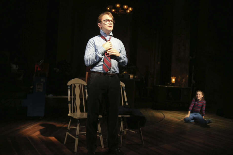 """FILE - This file image released by The Public Theater shows Michael Cerveris and Sydney Lucas in """"Fun Home."""" The musical is adapted from Alison Bechdel's graphic memoir about growing up in a funeral home with a closeted gay dad. (AP Photo/The Public Theater, Joan Marcus, file)"""