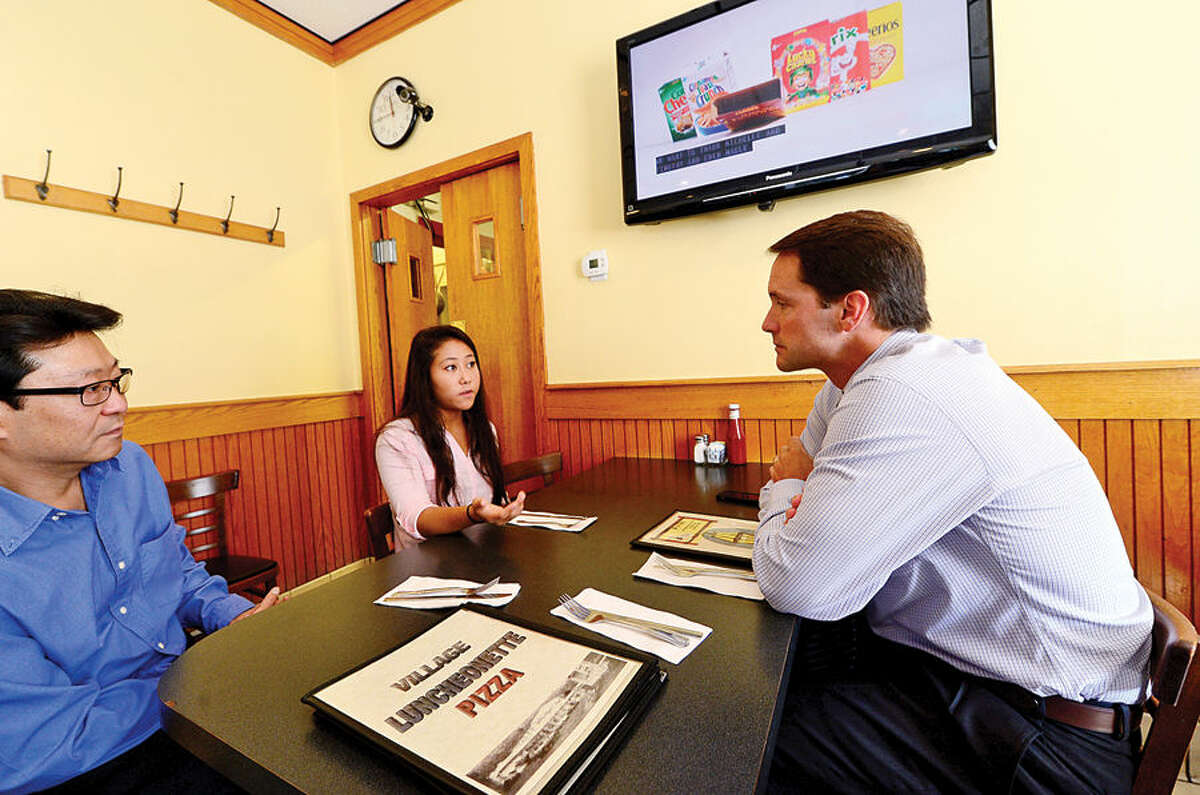 """Congressman Jim Himes, right, visits with Wilton High School senior Julianna Yee and her father, Bill Yee, who have created a new """"parent-friendly""""social networking site named """"The Portalz."""""""
