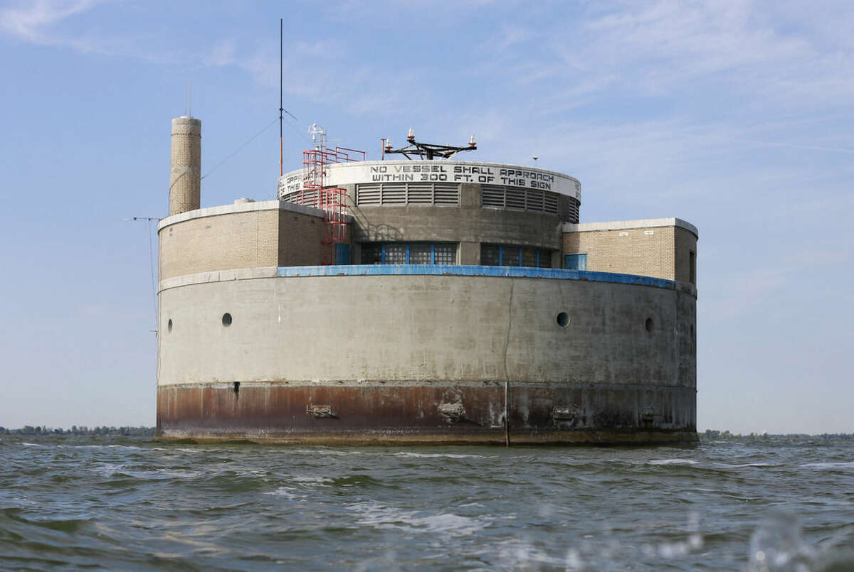 This Tuesday, Sept. 15, 2015 photo shows the City of Toledo water intake crib, approximately 2.5 miles off the shore of Curtice, Ohio. Algae blooms in Lake Erie, fed by agriculture runoff and overflowing sewer pipes, have become so toxic that they shut down Toledo's water system for two days in the summer of 2014 and have the city looking at spending millions to avoid a repeat. (AP Photo/Haraz N. Ghanbari)