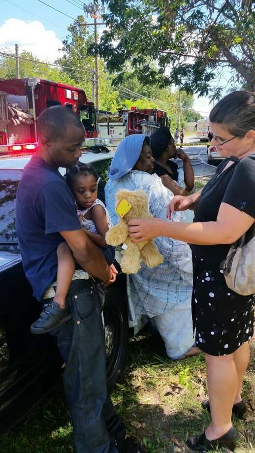 Michele DeLuca Norwalk Deputy Director, Emergency Managementhanding young fire victim a teddy bear to ease her pain pic.twitter.com/DiNoBTaf6F
