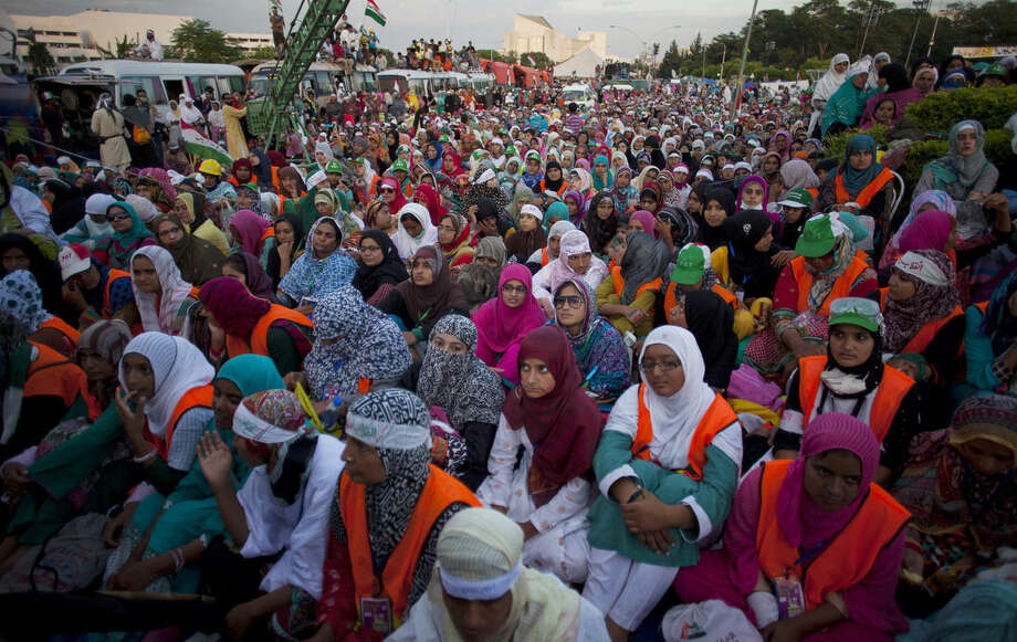 Supporters of Pakistani Muslim cleric Tahir-ul-Qadri listen to their leader during a sit-in protest near the parliament building in Islamabad, Pakistan, Thursday, Aug. 28, 2014. Pakistani police have registered a murder case against Prime Minister Nawaz Sharif, his brother Shahbaz, key cabinet members and senior officials on charges of abetting 14 murders of the supporters of a fiery cleric who has been leading for two weeks thousands of anti-government protests in capital Islamabad. (AP Photo/B.K. Bangash)