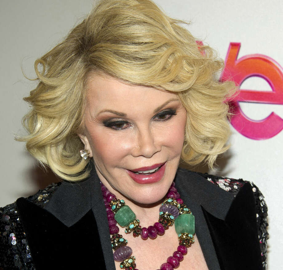 "FILE - In this Jan. 19, 2012, file photo, Joan Rivers attends a screening of the Season 2 premiere of WE TV's ""Joan & Melissa: Joan Knows Best?"" in New York. Two police officials say Rivers has been rushed in cardiac arrest from a doctor's office to a New York City hospital, Thursday, Aug. 28, 2014. (AP Photo/Charles Sykes, File)"