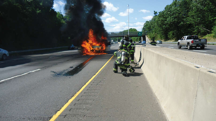 Contributed photoNorwalk Firefighters respond to a fully involved car fire on I-95 Thursday afternoon.