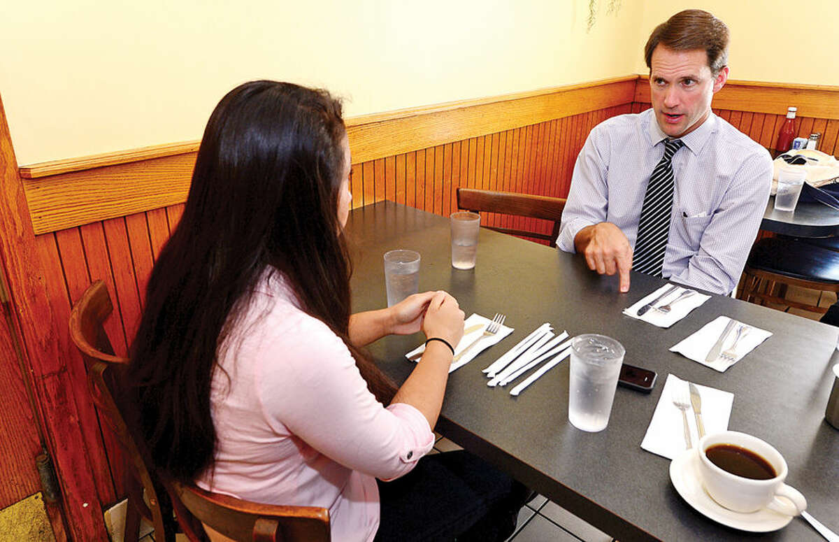 """Congressman Jim Himes, right, visits with Wilton High School senior Julianna Yee, who has created a new """"parent-friendly""""social networking site named """"The Portalz."""""""