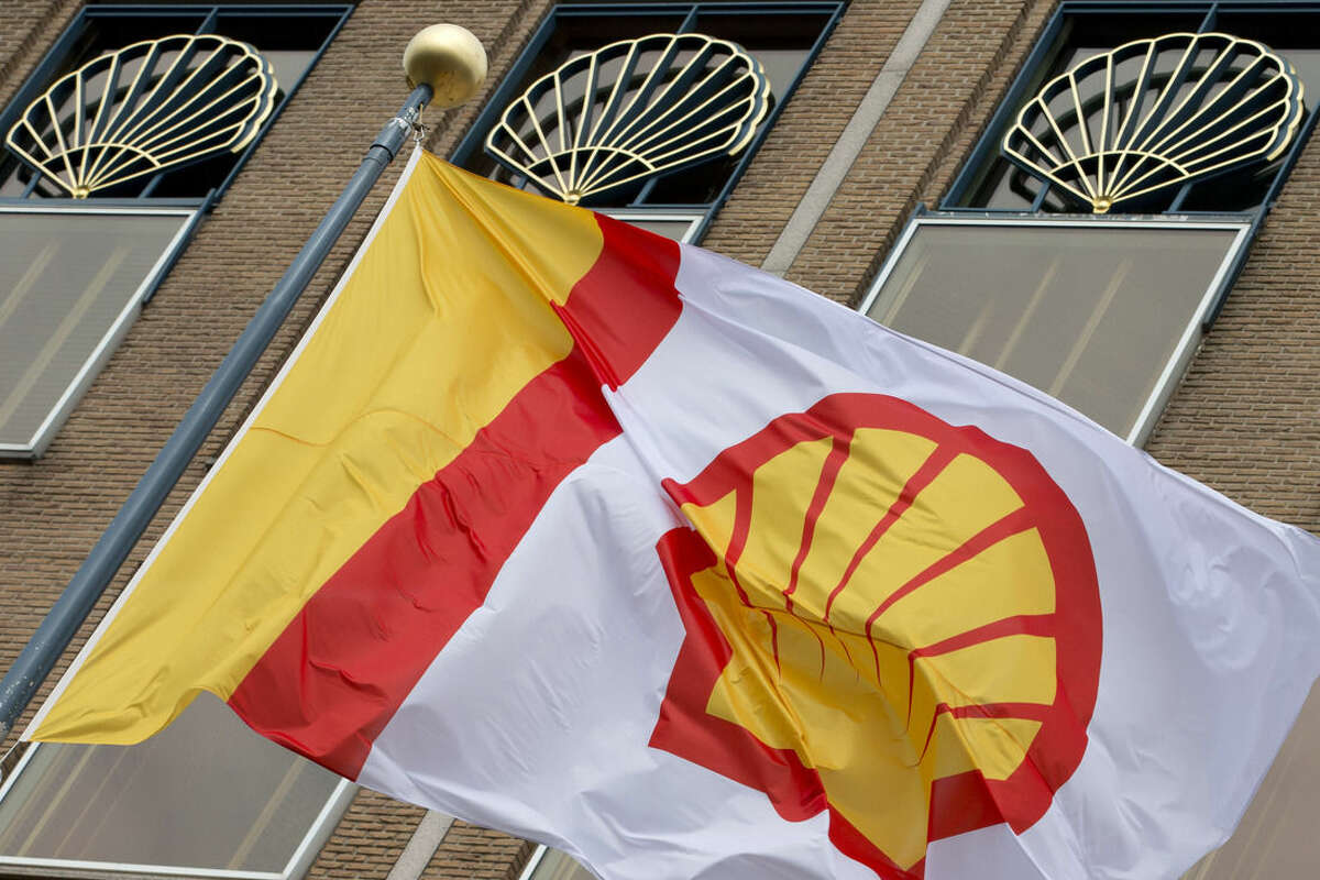FILE - In this Monday, April 7, 2014 file photo, a flag bearing the company logo of Royal Dutch Shell, an Anglo-Dutch oil and gas company, flies outside the head office in The Hague, Netherlands. Royal Dutch Shell will cease exploration in Arctic waters off Alaska's coast following disappointing results from an exploratory well backed by billions in investment and years of work. The announcement that came on Monday, Sept. 28, 2015 was a huge blow to Shell, which was counting on offshore drilling in Alaska to help it drive future revenue. Environmentalists, however, had tried repeatedly to block the project and welcomed the news. (AP Photo/Peter Dejong, File)