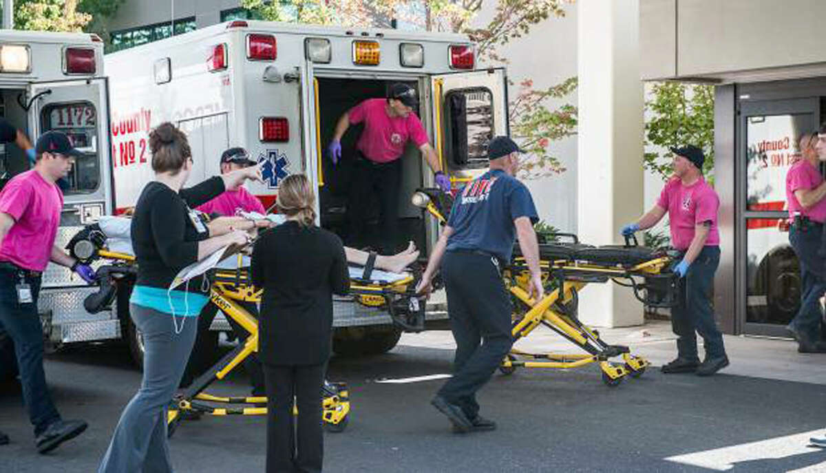 Aaron Yost/Roseburg News-Review via AP A patient is wheeled into the emergency room at Mercy Medical Center in Roseburg, Ore., following a deadly shooting at Umpqua Community College, in Roseburg, Thursday, Oct. 1, 2015.