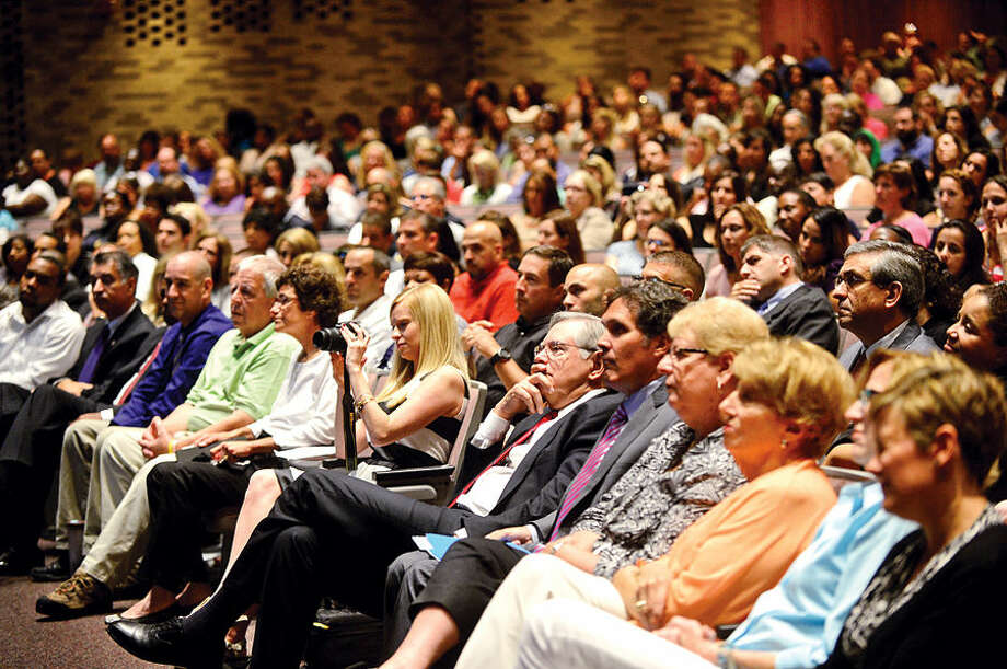 Hour photo / Erik Trautmann A crowded auditorium listens to Superintendent of Schools Winifred Hamilton make her remarks for the new school year during the Stamford Public Schools teacher convocation at Westhill High School Wednesday.