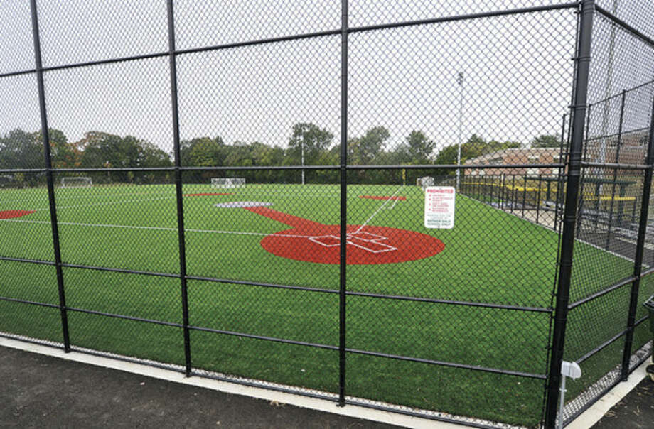 Hour photo/Erik TrautmannThe new baseball field at Nathan Hale Middle School will be christened on Saturday..