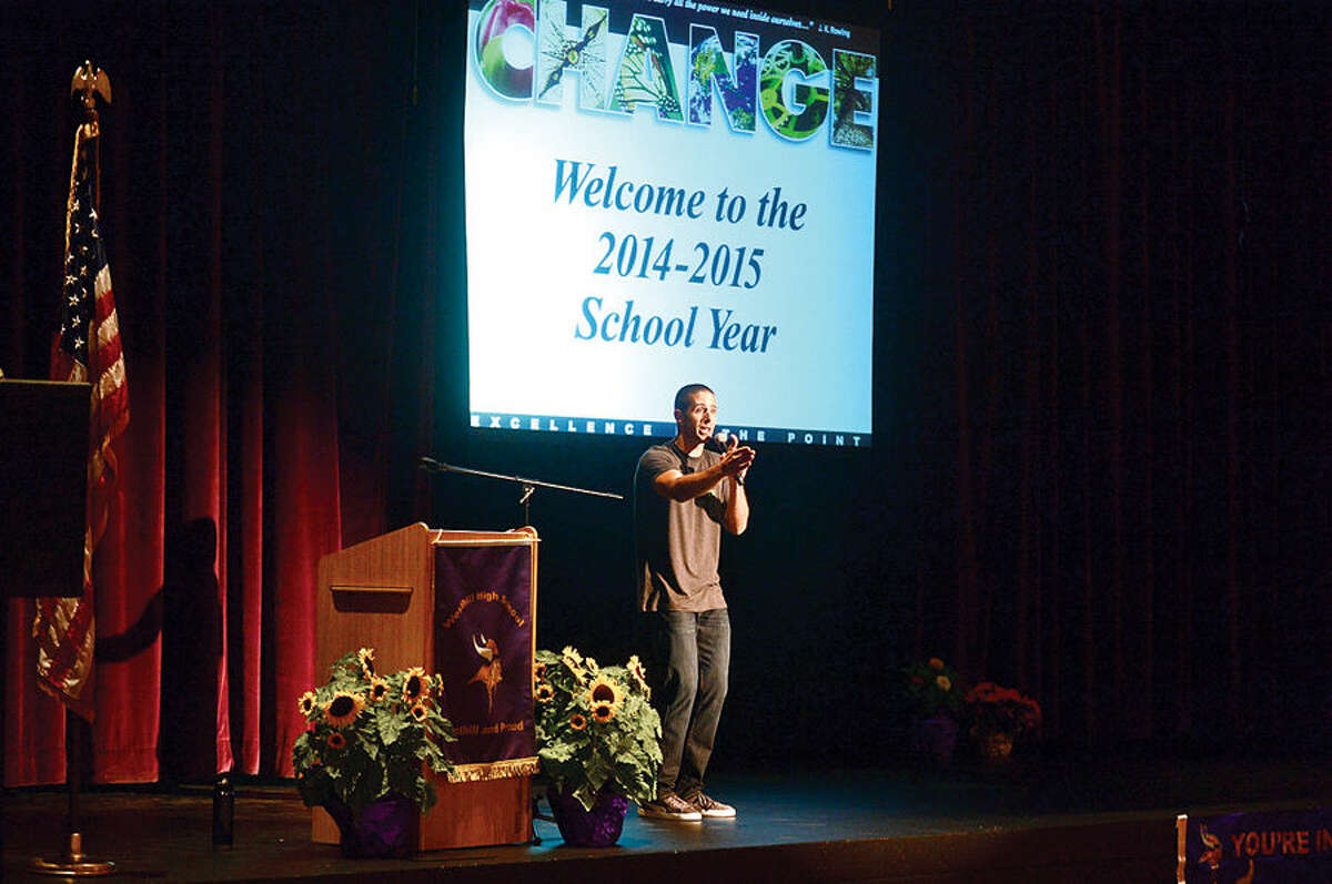 Hour photo / Erik Trautmann Stamford Teacher of the Year and keynote speaker, Jimmy Sapia, remarks for the new school year during the Stamford Public Schools teacher convocation at Westhill High School Wednesday.