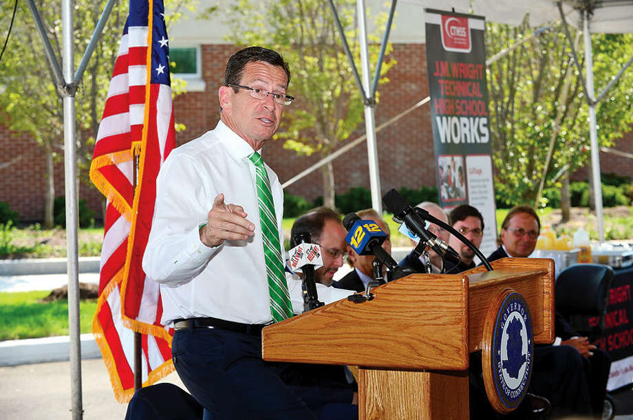 Hour photo / Erik Trautmann Connecicut Governor Dannell Malloy makes remarks during the J.M. Wright Tech Opening Day ribbon cutting ceremony Wednsaday morning.