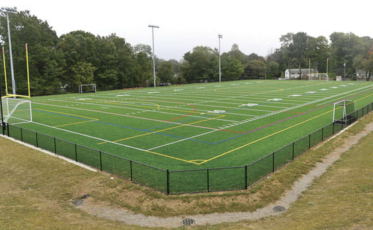 Hour photo/Erik Trautmann The new football, soccer, lacrosse field at Nathan Hale Middle School will be christened on Saturday.