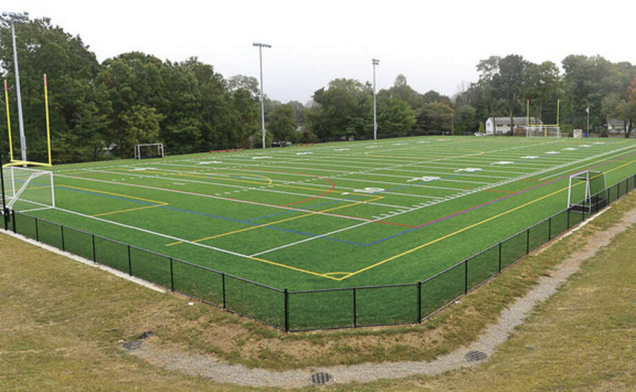 Hour photo/Erik TrautmannThe new football, soccer, lacrosse field at Nathan Hale Middle School will be christened on Saturday.