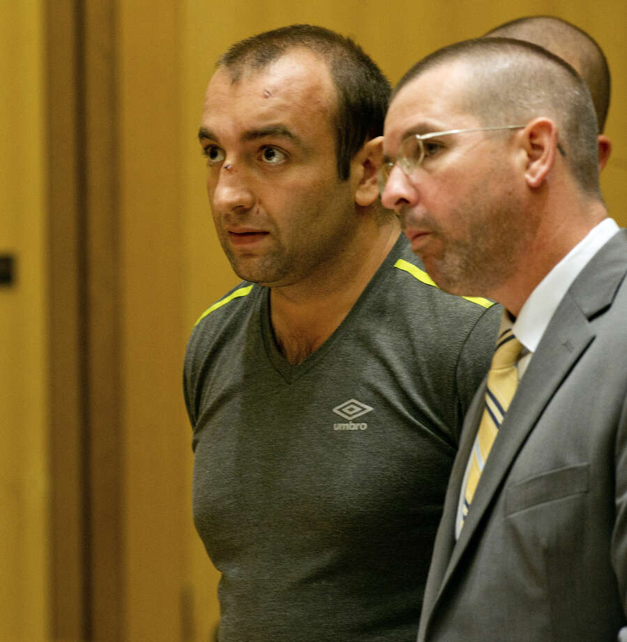 Shota Mekoshvili, with his attorney Lindy Urso in State Superior Court in Stamford, Conn., on Friday, August 29, 2014. Mekoshvili is accused of murdering Mohammed Kamal, the Stamford Taxi driver found near his cab on Doolittle Road earlier this week.(Mandatory Credit - Lindsay Perry/Stamford Advocate)