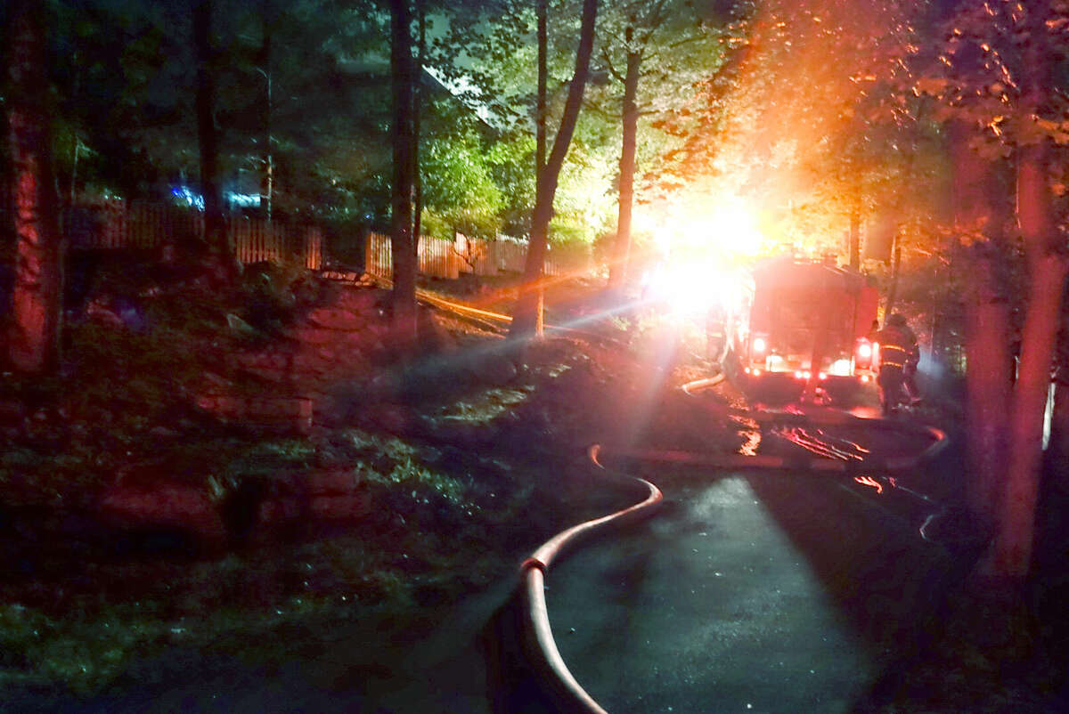 Hour photo/Chris Bosak Norwalk firefighters respond to a fully involved structure fire at 56 Witch Lane Thursday night.