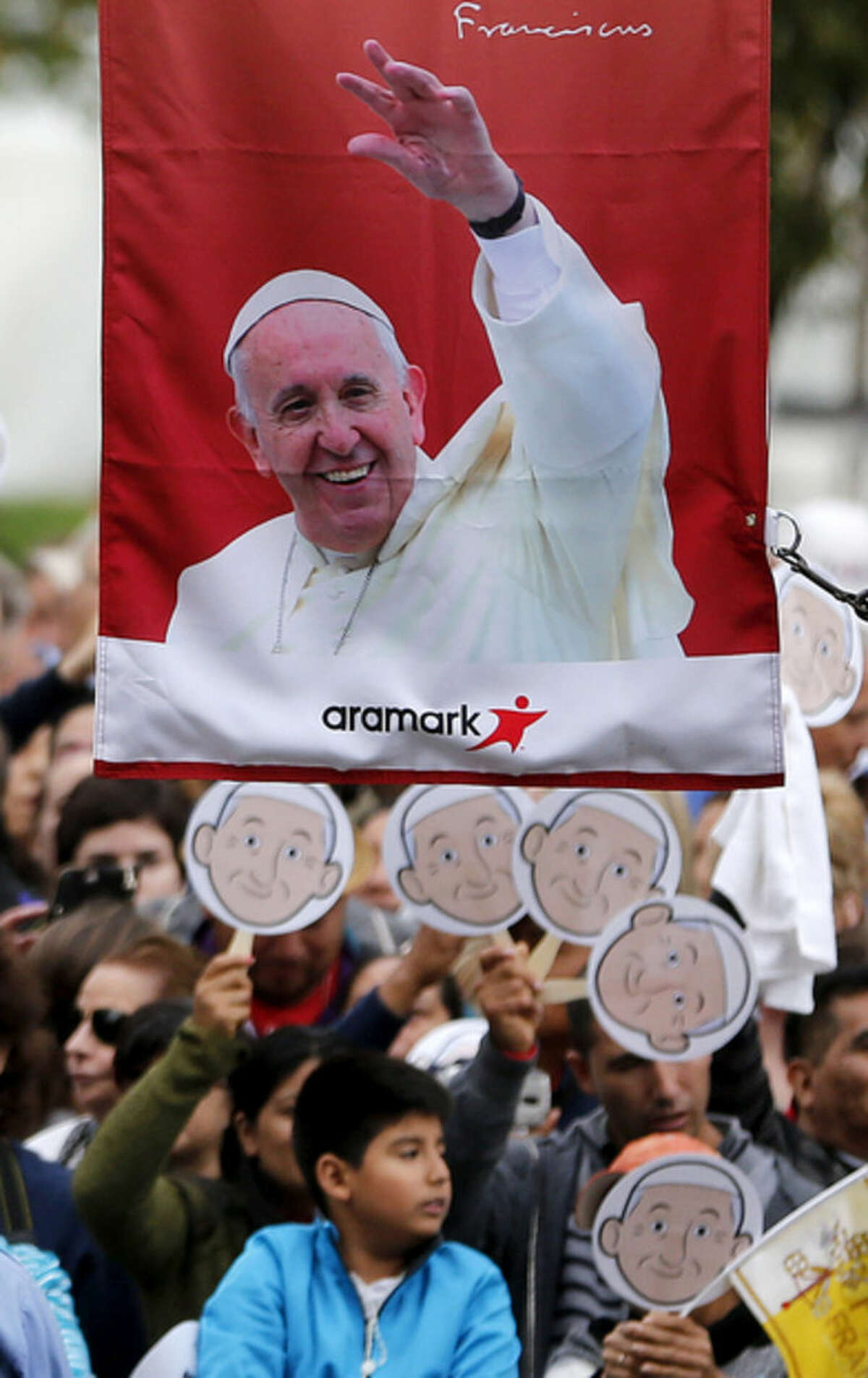People gather in hopes to catch a look of Pope Francis before he arrives for a mass at Cathedral Basilica of Sts. Peter and Paul, Saturday, Sept. 26, 2015, in Philadelphia. (AP Photo/Julio Cortez)