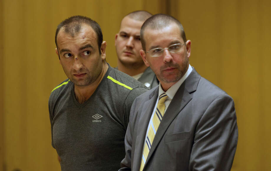 Shota Mekoshvili, with his attorney Lindy Urso, in State Superior Court in Stamford, Conn., on Friday, August 29, 2014. Mekoshvili is accused of murdering Mohammed Kamal, the Stamford Taxi driver found near his cab on Doolittle Road earlier this week.(Mandatory Credit - Lindsay Perry/Stamford Advocate)