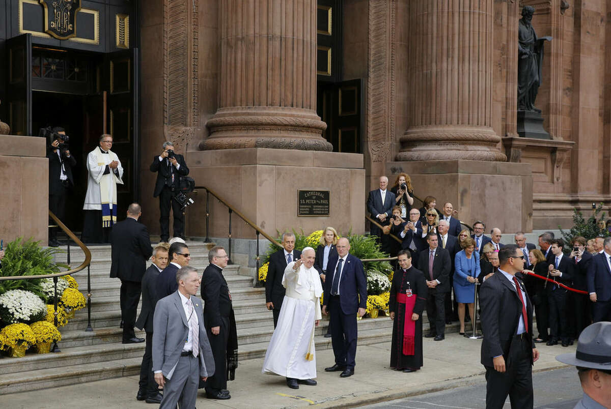 Pope Francis waves as he arrives for a mass at the Cathedral Basilica of Sts. Peter and Paul in Philadelphia, Saturday, Sept. 26, 2015. (AP Photo/Patrick Semansky)