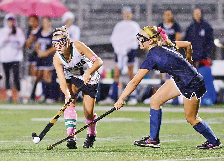 Hour photo / Erik Trautmann Norwalk High School Field Hockey captain Sarah Roddy avoids a Staples defender on Thursday.