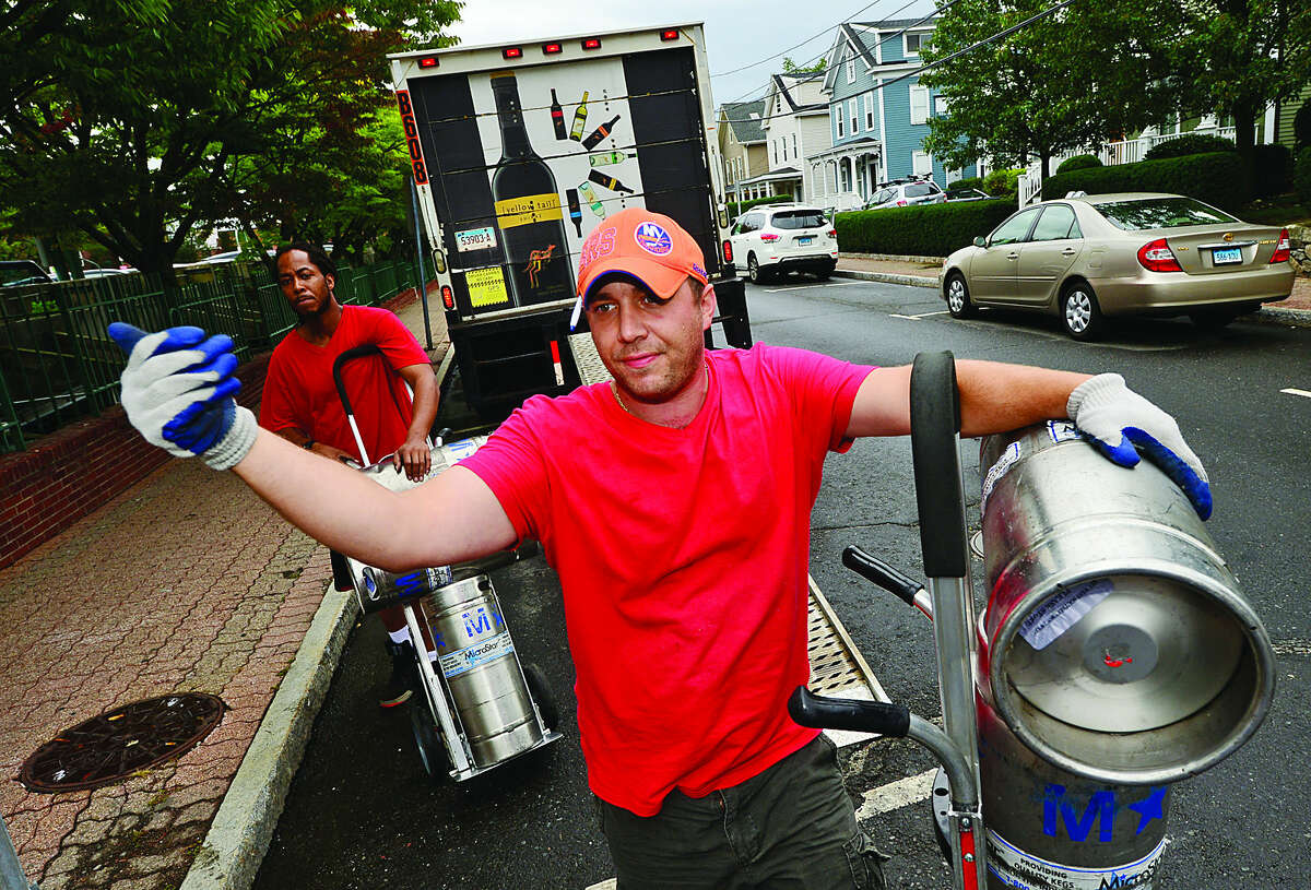 Hour photo / Erik Trautmann Eric Badiali ofBrescome and Barton makes a delivery on Haviland St Wednesday ahead of the move by the city to reverse the directions of the one way streets, Haviland and Elizabeth, in South Norwalk on Monday.