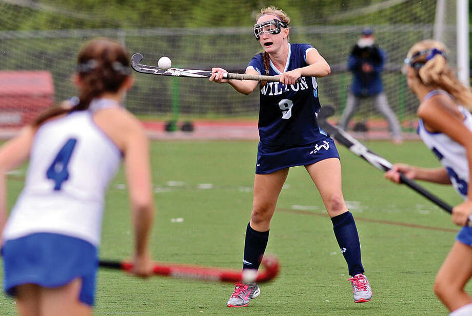 Hour photo / Erik Trautmann Gwendolyn Hall for Wilton high School Girls Field Hockey team moves the ball during their game against Darien Thursday.