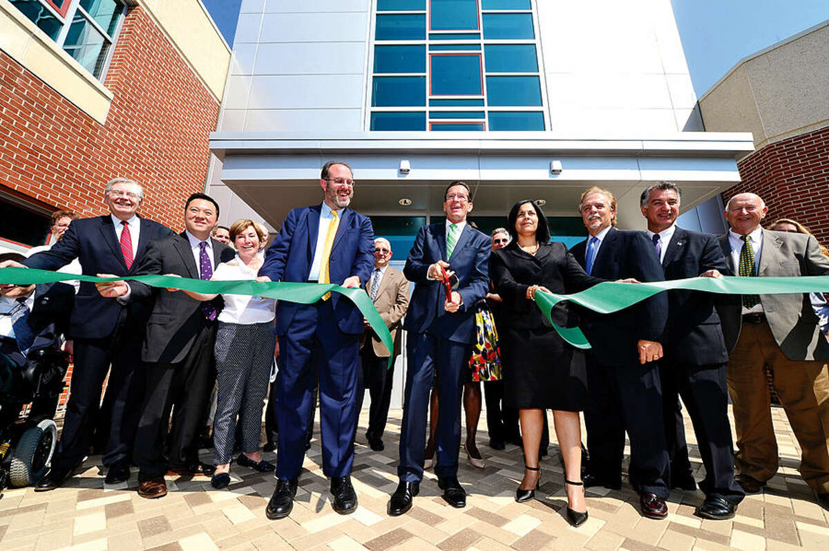 Hour photo / Erik Trautmann State and local official joinConnecticut Governor Dannell Malloy, cenetr, cut the ribbon during the J.M. Wright Technical School Opening Day ceremony Wednesday morning.