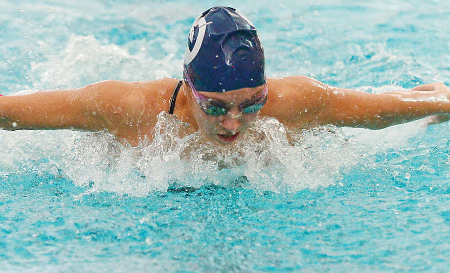 Hour photo / Erik Trautmann Natalie Larsen competes in the 200IM for Wilton in their swim meet against Norwalk at the Wilton YMCA Wednesday.
