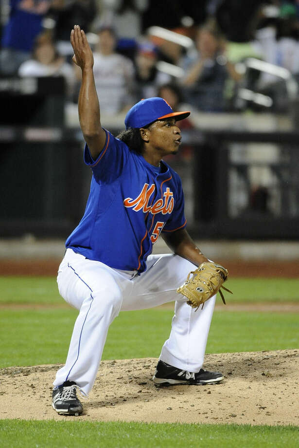 New York Mets relief pitcher Jenrry Mejia celebrates after his team defeated the Philadelphia Phillies 4-1 in a baseball game at Citi Field, Friday, Aug. 29, 2014, in New York. (AP Photo/Kathy Kmonicek)