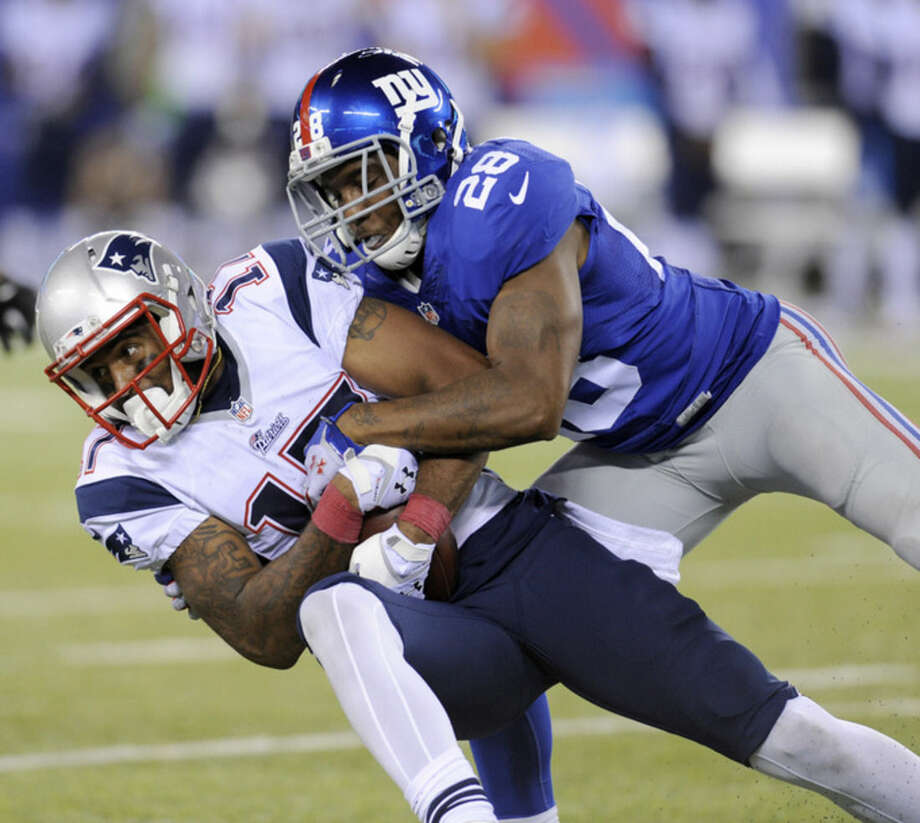 New England Patriots' Aaron Dobson, left, is tackled by New York Giants' Jayron Hosley during the second half of an NFL preseason football game, Thursday, Aug. 28, 2014, in East Rutherford, N.J. (AP Photo/Bill Kostroun)
