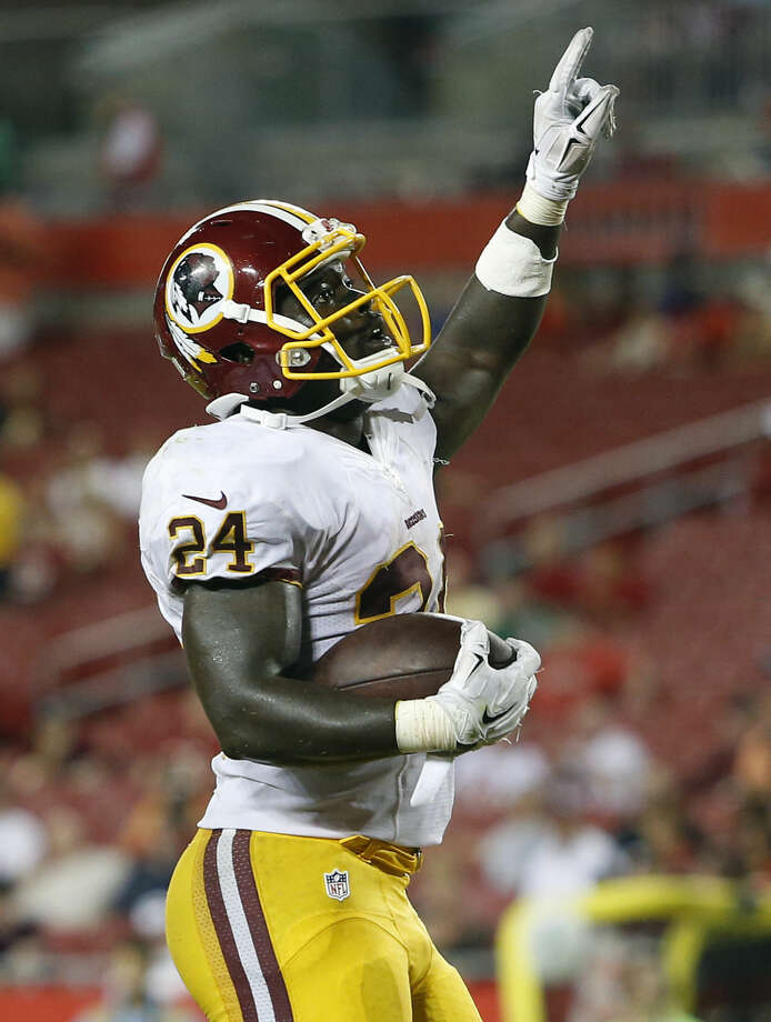 Washington Redskins running back Silas Redd celebrates after scoring against the Tampa Bay Buccaneers during the fourth quarter of an NFL preseason football game Thursday, Aug. 28, 2014, in Tampa, Fla. (AP Photo/Brian Blanco)
