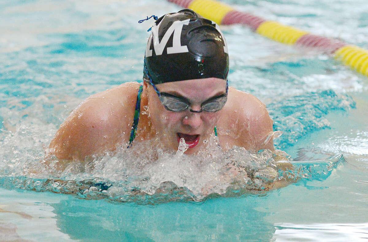 Hour photo / Erik Trautmann Olivia Fassett compets for Norwalk against Wilton in their swim meet at the Wilton YMCA Wednesday.