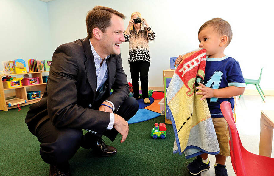 Hour photo / Erik Trautmann US Congressman Jim Himes meets with Joshua Juarez as he tours the Head Start program at Nathaniel Ely Elementary School to discuss his advocacy for Head Start and early education programs Friday morning.