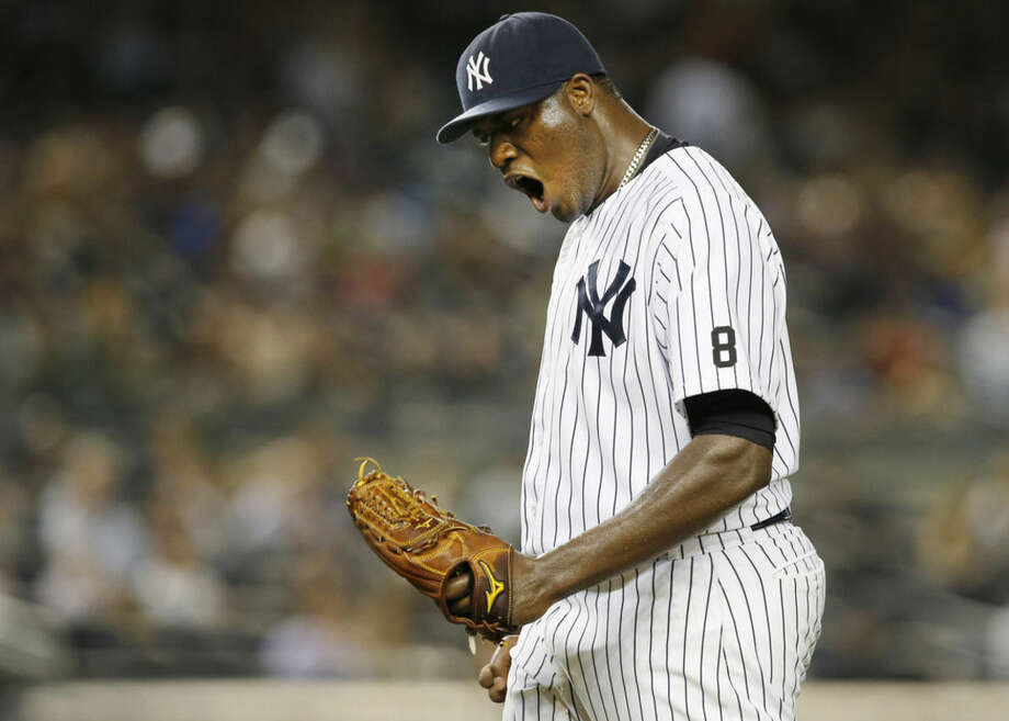 New York Yankees pitcher Michael Pineda shouts after Boston Red Sox's Mookie Betts hit a home run in a baseball game in New York, Tuesday, Sept. 29, 2015. (AP Photo/Kathy Willens)