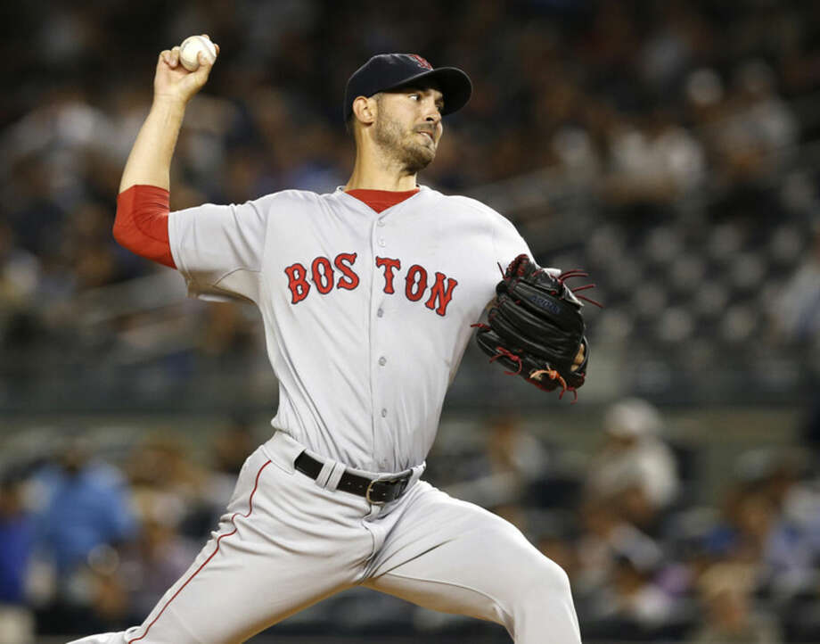 Boston Red Sox pitcher Rick Porcello delivers in the first inning of a baseball game against the New York Yankees in New York, Tuesday, Sept. 29, 2015. (AP Photo/Kathy Willens)