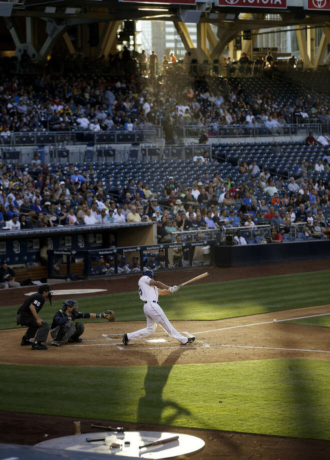 San Diego Padres' Will Venable grounds out while batting against the Milwaukee Brewers during the second inning in a baseball game Wednesday, Aug. 27, 2014, in San Diego. (AP Photo/Gregory Bull)