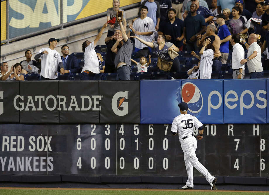 New York Yankees right fielder Carlos Beltran (36) watches as a spectator catches Blake Swihart's eighth-inning two-run home run in a baseball game in New York, Tuesday, Sept. 29, 2015. (AP Photo/Kathy Willens)