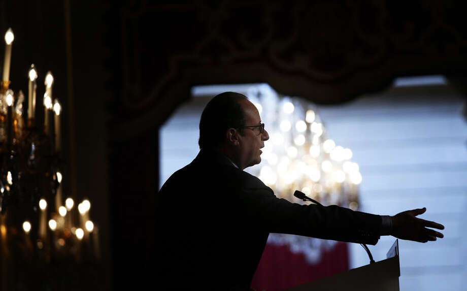French President Francois Hollande delivers his speech to French Ambassadors at the Elysee Palace, in Paris Thursday, Aug. 28. 2014. The French leader who once decried global finance and vowed a 75-percent tax on millionaires has quashed dissent from his Socialist government's left flank and appointed a well-heeled former investment banker as his new point man on the economy. (AP Photo/Christophe Ena, Pool)