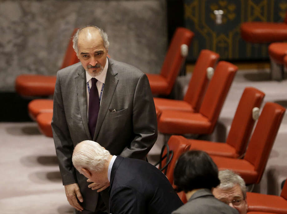 Syrian Ambassador to the United Nations Bashar Jaafari arrives for a Security Council meeting at United Nations headquarters, Wednesday, Sept. 30, 2015. (AP Photo/Seth Wenig)