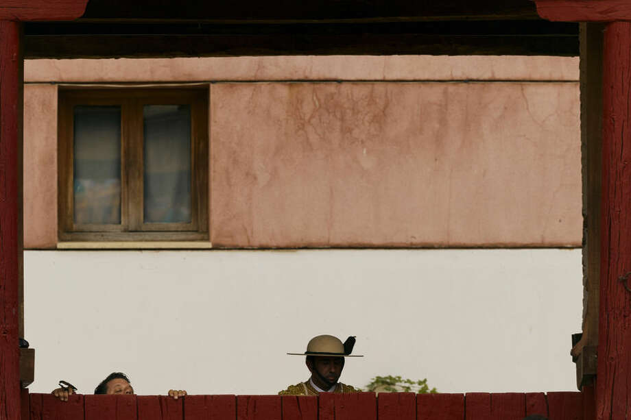 A man tries to see the show from outside the bullring during a bullfight in Toro, Spain, Thursday, Aug. 28, 2014. In August hundreds of villages around Spain celebrate their patron saints, with bullfights, music and parties on the streets.(AP Photo/Daniel Ochoa de Olza)