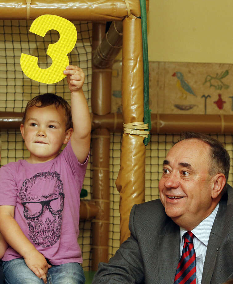 Scotland's First Minister Alex Salmond visits a children's activity center in Edinburgh, Friday, Aug, 29, 2014. British Prime Minister David Cameron and Salmond hit the referendum campaign trail today as the battle over the future of the United Kingdom intensifies. The Scottish referendum will be held on Sept. 18. (AP Photo/Danny Lawson, PA Wire) UNITED KINGDOM OUT - NO SALES - NO ARCHIVES