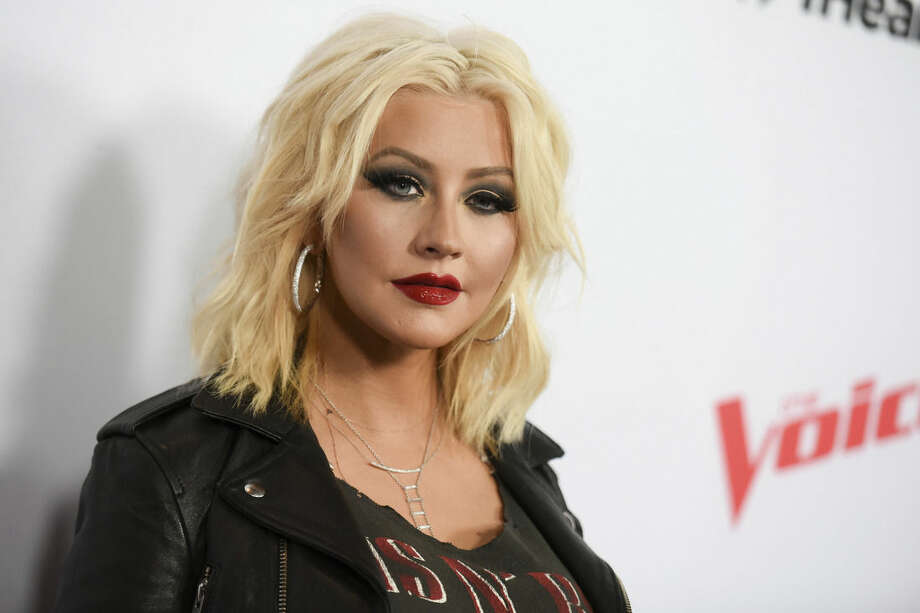 """FILE - In this April 23, 2015 file photo, Christina Aguilera arrives at Season 8 of """"The Voice"""" Red Carpet Event in West Hollywood, Calif. Aguilera was on a humanitarian trip in Ecuador last week filming a new PSA for Yum! Brands World Hunger Relief effort that raises awareness, volunteerism and funds for WFP and other hunger relief agencies. (Photo by Richard Shotwell/Invision/AP, File)"""