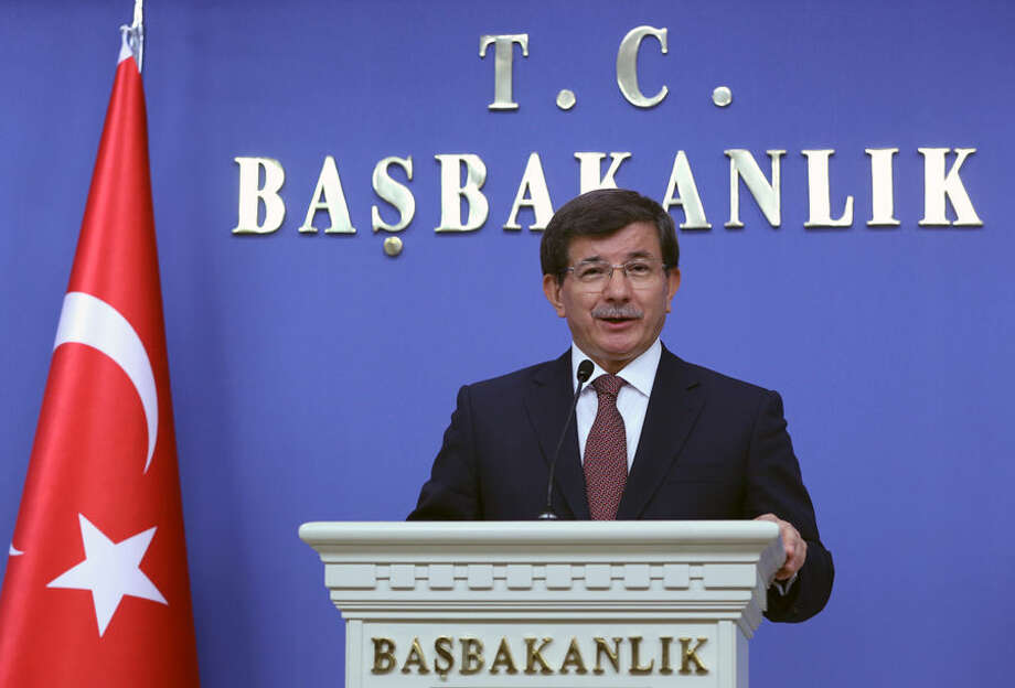 Turkey's new Prime Minister Ahmet Davutoglu announces his cabinet ministers in Ankara, Turkey, Friday, Aug. 29, 2014. Davutoglu reappointed all key ministers who served under the new president, Recep Tayyip Erdogan, signaling that there would be no change in direction. Erdogan, who has dominated Turkish politics for over a decade, was sworn in as Turkey's first popularly elected president on Thursday. He has picked former foreign minister and loyal ally Davutoglu to succeed him as prime minister and immediately asked him to form a new government.(AP Photo/Burhan Ozbilici)