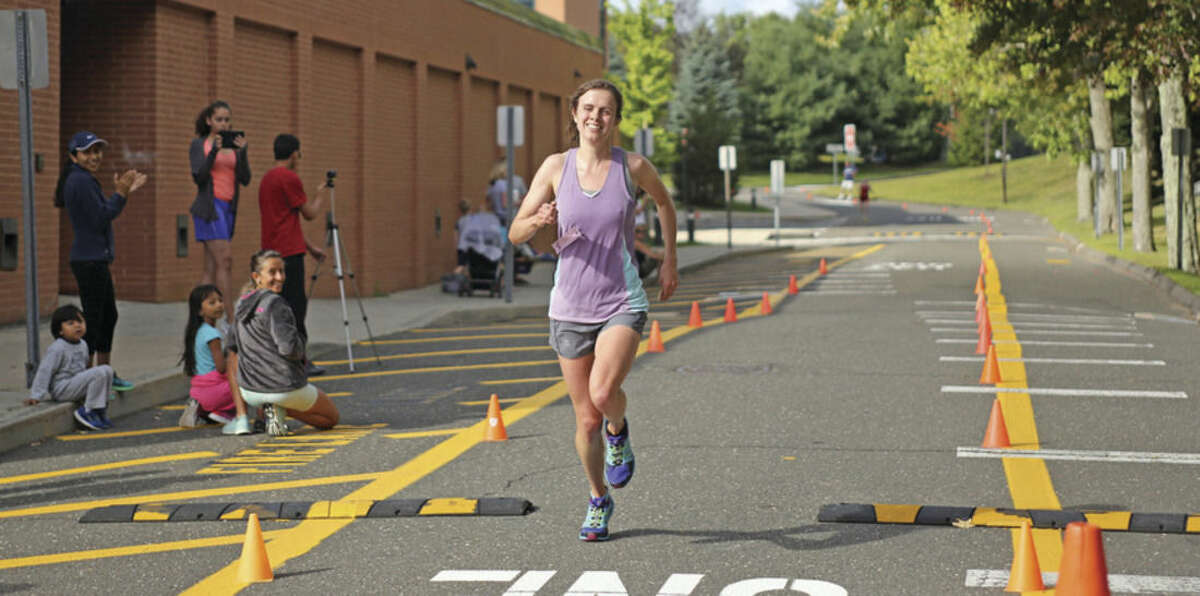 Hour Photo / Danielle Calloway Kerri Lyons comes in first place for the women's division during the last Westport Road Runners Road Race, which was a 10-miler, held on Saturday morning at Staples High School.
