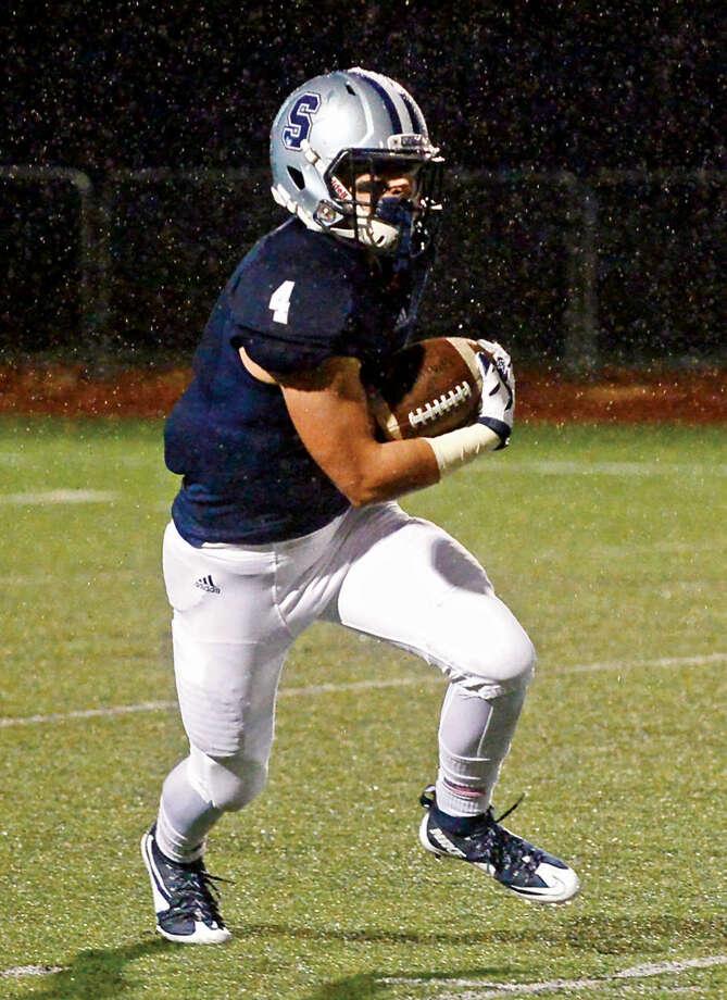 Hour photo / Erik Trautmann Staples High School Football takes on Fairfield Warde Friday night in Westport.