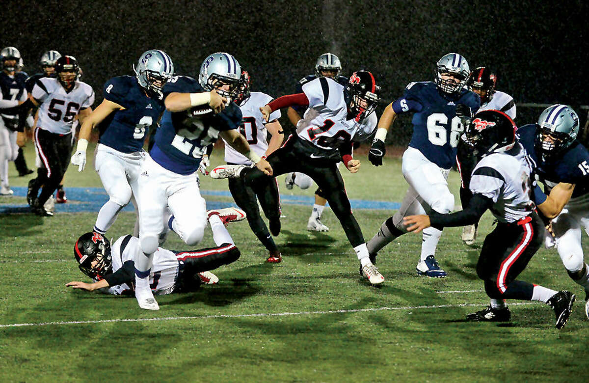 Hour photo / Erik Trautmann Staples High School Football takes on Fairfield Warde Friday night in Westport.