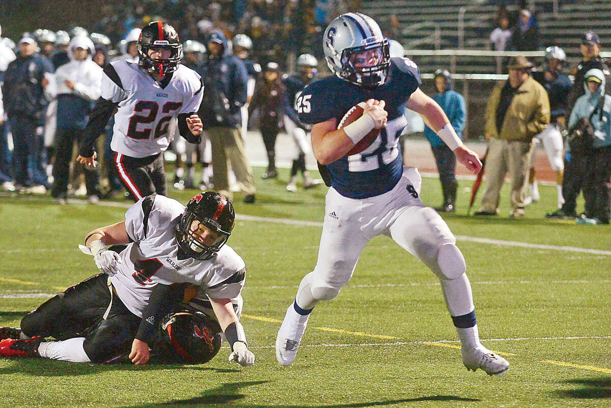 Staples High running back Ethan Burger looks to cross the goal line as the Wreckers battled Fairfield Warde Friday night in Westport. Staples won, 35-15. (Hour photo/Erik Trautmann)